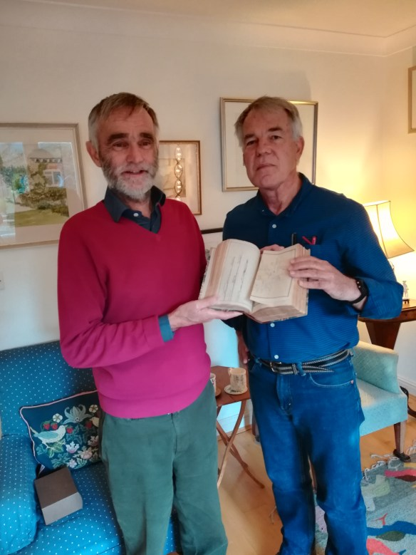 The donor of the logbook, Mr Anthony Gannon, presenting it to Dr Nigel Erskine. The book was  passed down through Mr Gannon's maternal grandfather. Image courtesy Nigel Erskine/ANMM.