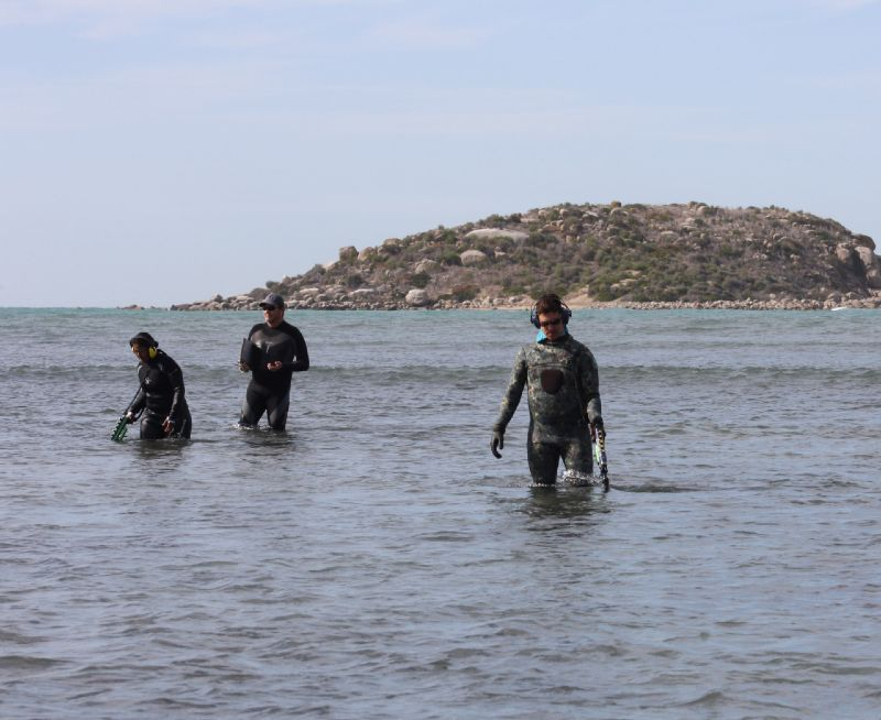 Maddy Chadrasekaran, Rick Bullers and Tim Zapor conduct a metal detector sweep within shallows just inshore of South Australian's wrecksite