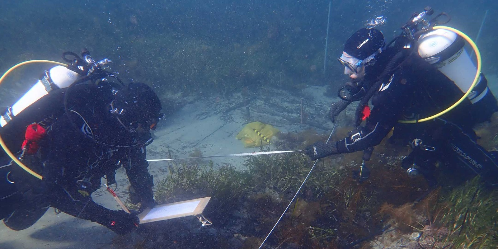 James Hunter (left) and Kieran Hosty use baseline-offset mapping to record the hull structure in South Australian's bow