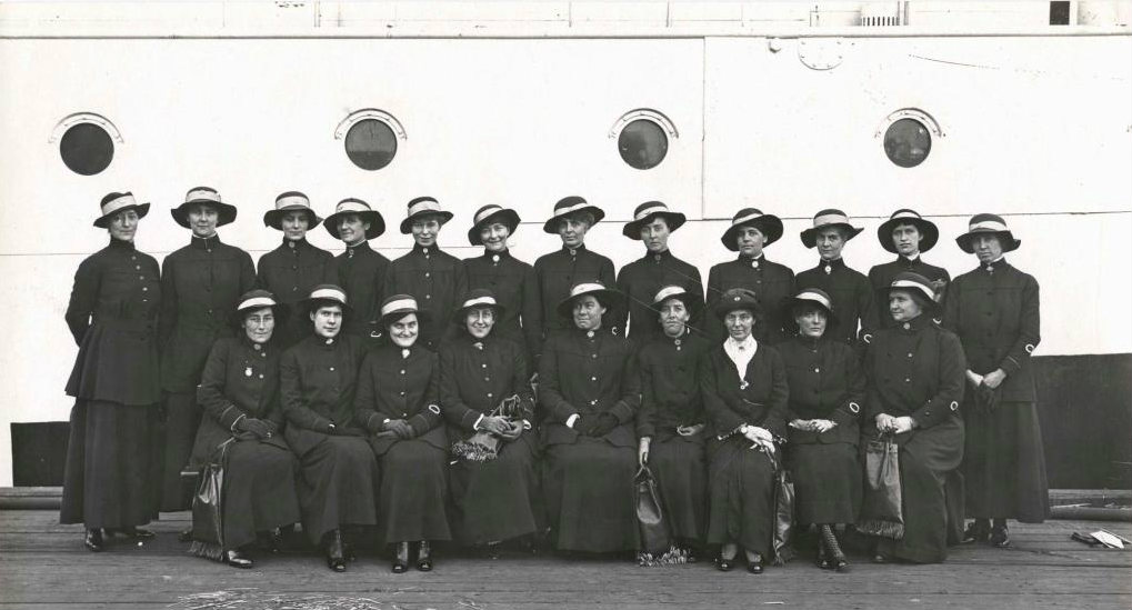 Red Cross 'Bluebird' nurses awaiting embarkation on the troopship Kanowna, Melbourne, 6 July 1916. Photographer: Josiah Earl Barnes, ANMM Collection 00027608