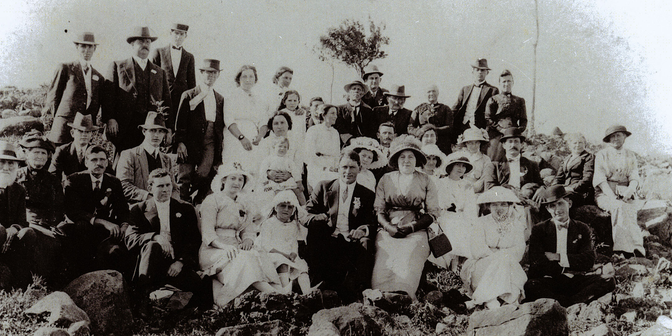 Going away party for the wedding of Maria and Lorenzo Roder's daughter, Mary (front row, holding handbag), c 1921. Maria and Lorenzo are in the back row, third and fourth from right. Reproduced courtesy Pauline Lovitt.