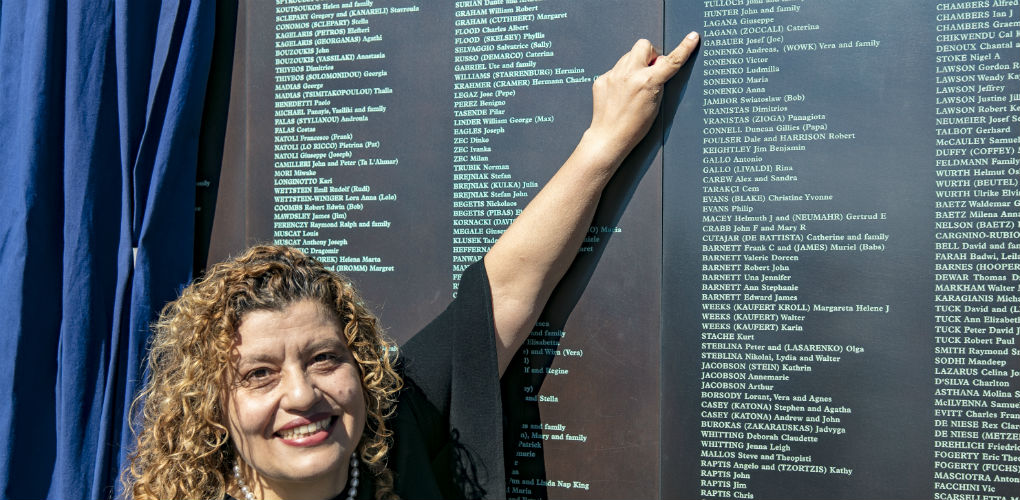 Welcome Wall unveiling ceremony, 7 May 2018. Mary Lagana, daughter of Giuseppe and Caterina from Calabria, Italy, and the newly unveiled name panel.