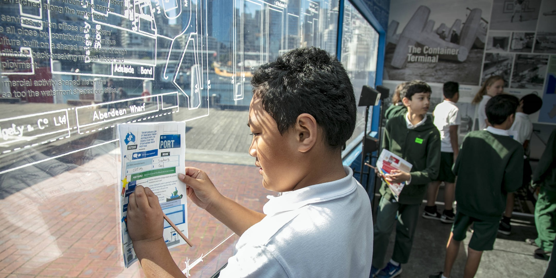 Exhibition education program. School kids visiting the 'Container' exhibition, Wharf side, ANMM, August 2018
