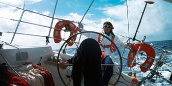 Kay Cottee - Steering Blackmores First Lady with foot across the Pacific Ocean. ANMM Collection, reproduced courtesy Kay Cottee.