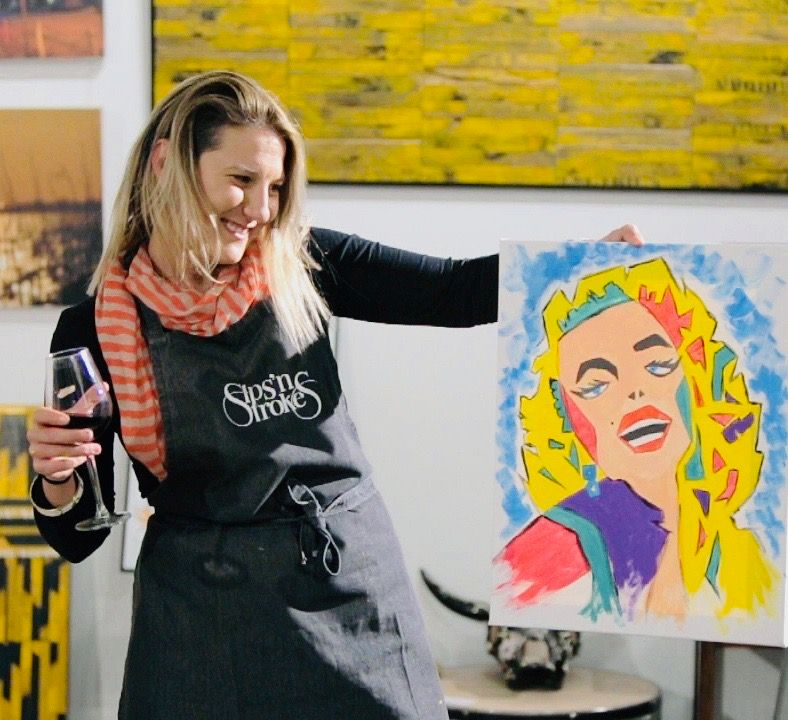 Woman displaying her finished Sip n Stroke art