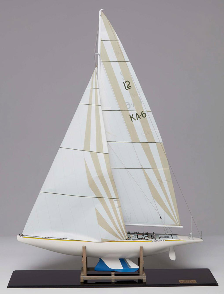 1:25 scale model of Australia II, Ben Lexcen's provocative design that won the America's Cup in 1983, after 132 years. The team of Australia II is honoured in the Australian Sailing Hall of Fame. The last of five test tank models used to develop the winged keel design is here in Wharf 7 foyer. ANMM Collection. Donated by Mr Albert YL Wong AM & Mrs Sophie Wong.