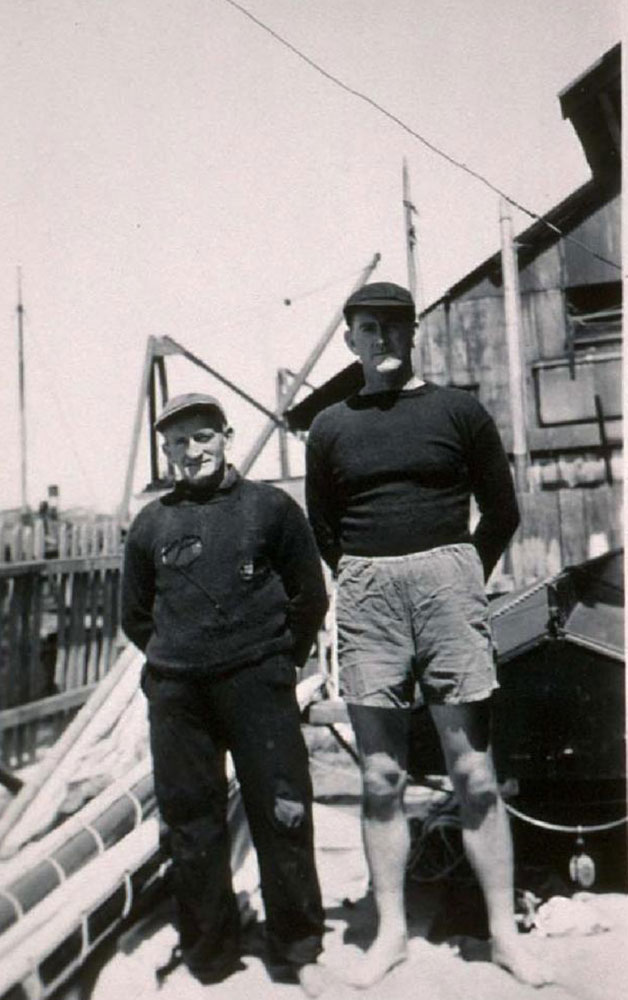 Wee' Georgie Robinson and Bob Lundie standing beside Britannia's rigging in Georgie 's boatyard in Balmain, 1943. ANMM Collection Gift from Peter Knight.