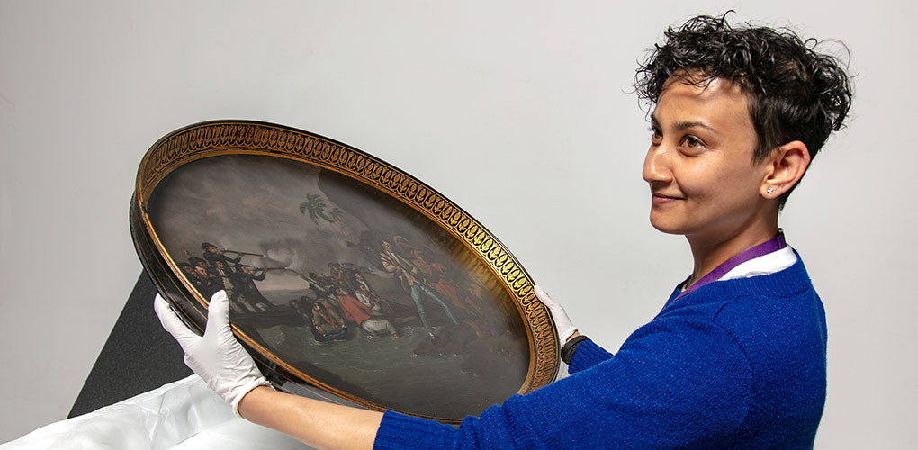 Registrar Anupa unpacking James Cook tea tray