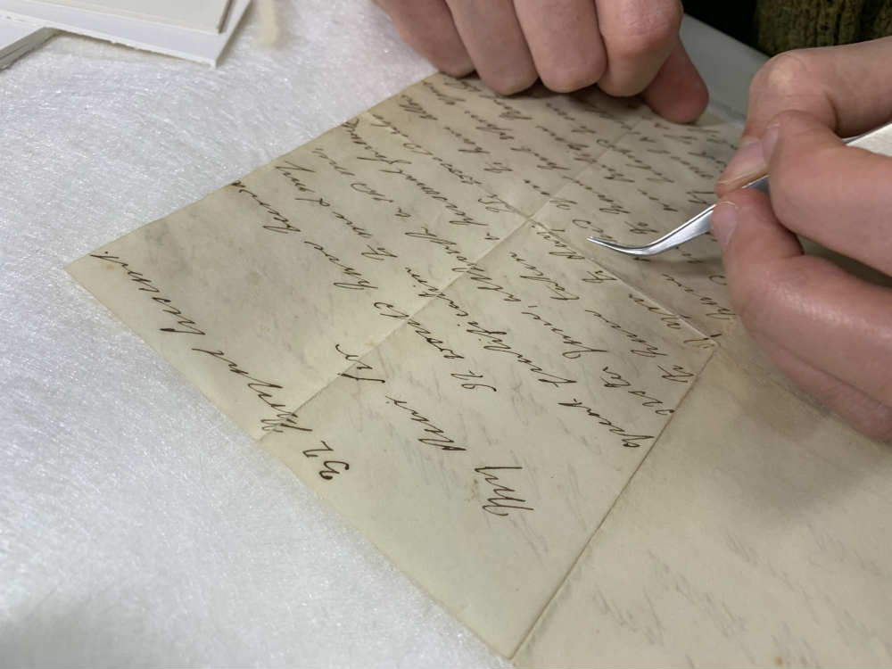 Conservator Katie Wood working on restoration of Fanny Bligh's letter. Image: ANMM