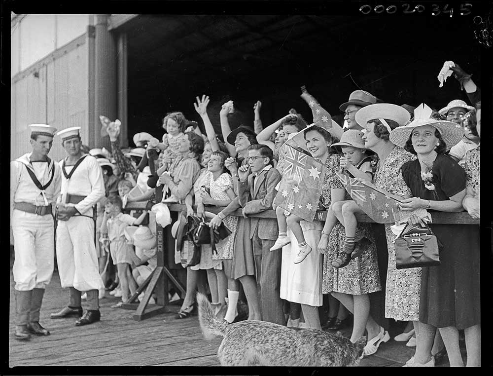 Crowd at Circular Quay waving to returning HMAS SYDNEY (II). Photo by Samuel Hood. 1941. Courtesy Australian War Memorial Collection.