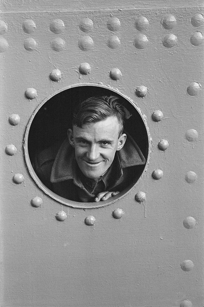 Smiling soldier on the troopship carrying 6th and 7th Divisions AIF to the Middle East. Photo by Edward Cranstone. 1940. Courtesy of Australian War Memorial Collection.