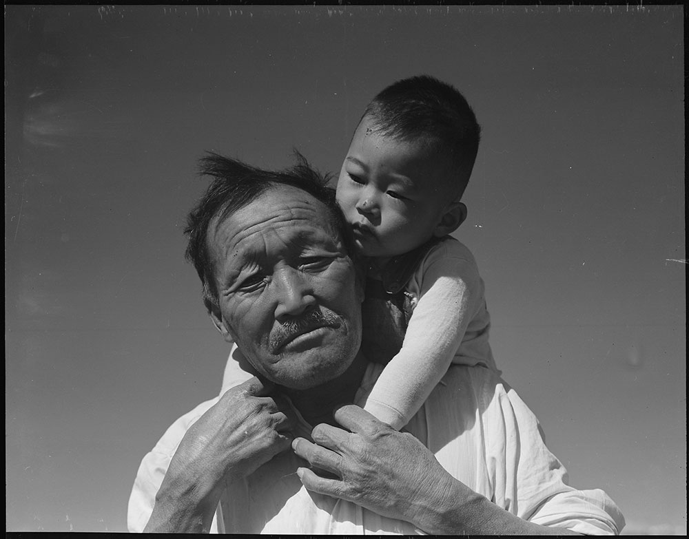 Grandfather and grandson of Japanese ancestry at Manzanar War Relocation Authority Center. Photo by Dorothea Lange, July 1942. Courtesy of Office of War Information Photograph Collection, Library of Congress.