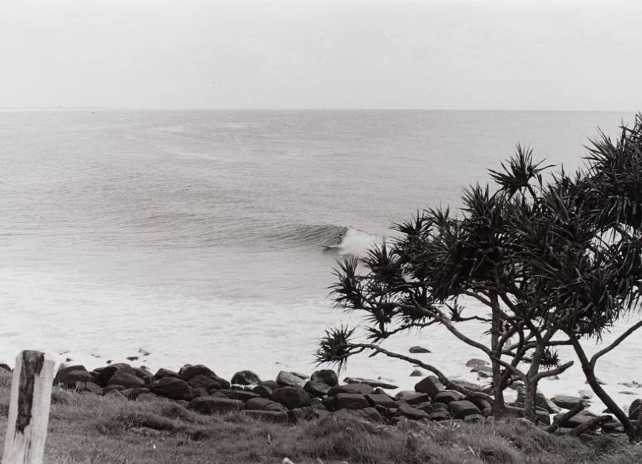 A surfer surfing the break off Greenmount Point, Coolangatta in Queensland, 1964  © Jack Eden. ANMM Collection Gift from Dawn and Jack Eden, ANMS1078[094]