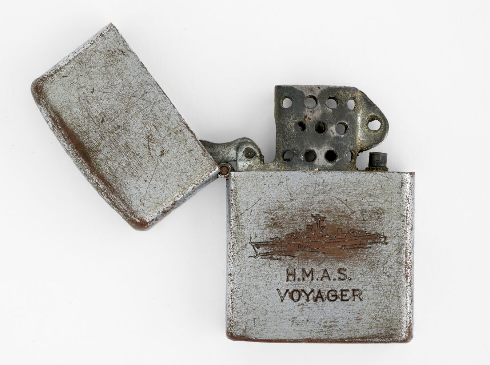 Cigarette lighter. Penguin. HMAS Voyager cigarette lighter. c.1964. ANMM Collection AX000759