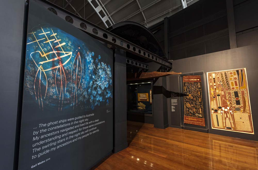 Under Southern Skies gallery entrance - 'Constellation' by Gail Mabo and 'Ganalpingu Cosmology' by John Bulun Bulun. Image: Andrew Frolows, ANMM.