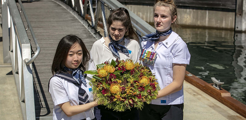 Student ambassadors laying a wreath at Remembrance Day ceremony.