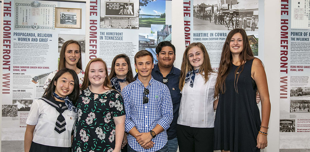 Students in front of their banners, which examine the homefront and will be a travelling exhibition.