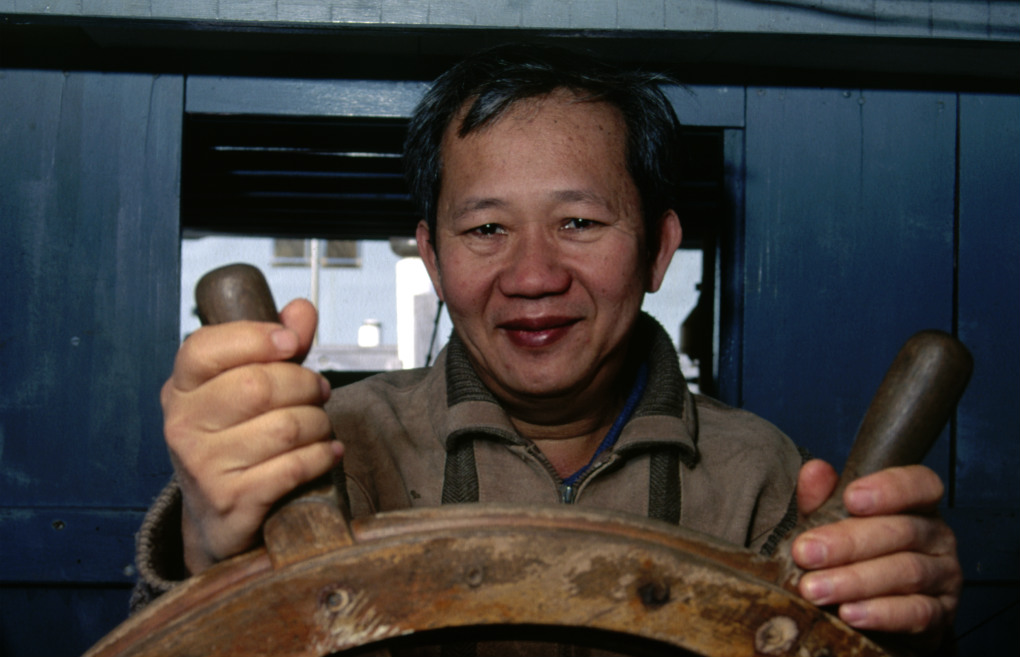 The original owner of Tu Do, Tan Thanh Lu aboard the vessel at the Maritime Museum in 1995. Photo: Jenni Carter for ANMM